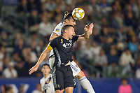 CARSON, CA - SEPTEMBER 15: Zlatan Ibrahimovic #9 of the Los Angeles Galaxy and Matt Besler #5 of Sporting Kansas City battle for a loose ball during a game between Sporting Kansas City and Los Angeles Galaxy at Dignity Health Sports Park on September 15, 2019 in Carson, California.