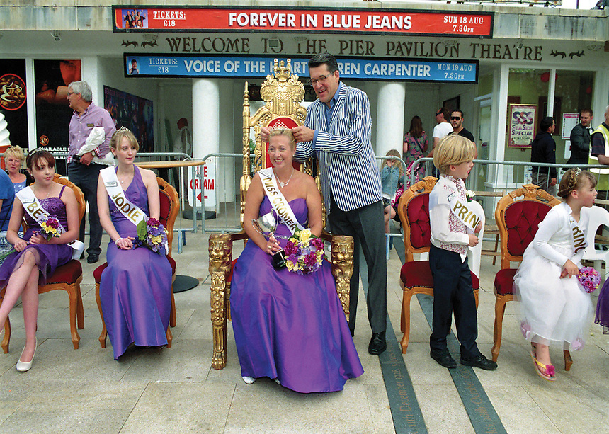 """Queen of Cromer, Jade Armstrong is crowned by Olly Day. The Queen is attended by Junior Princess Bethany Cuff, senior Princess Jodie Rice, & Prince Oliver Fraser.<br /> <br /> """"For a town like Cromer it is important to keep certain traditions going."""""""