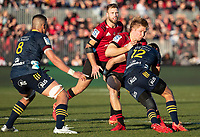 Jack Goodhue is tackled during the 2020 Super Rugby match between the Crusaders and Highlanders at Orangetheory Stadium in Christchurch, New Zealand on Saturday, 9 August 2020. Photo: Joe Johnson / lintottphoto.co.nz