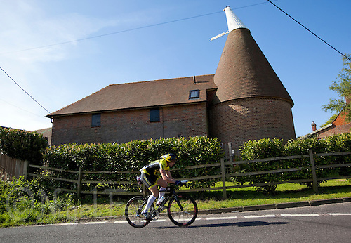 16 MAY 2010 - LYDD, GBR - A competitor passes an old Oasthouse during the The Marshman Triathlons (PHOTO (C) NIGEL FARROW)