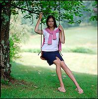 Young woman seated on tree swing&#xA;<br />