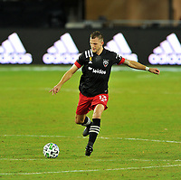 WASHINGTON, DC - SEPTEMBER 27: Frederic Brilliant #13 of D.C. United moves the ball during a game between New England Revolution and D.C. United at Audi Field on September 27, 2020 in Washington, DC.