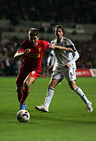 Pictured: Michu of Swansea (R) against Steven Gerrard of Liverpool (L).<br /> Monday 16 September 2013<br /> Re: Barclay's Premier League, Swansea City FC v Liverpool at the Liberty Stadium, south Wales.