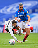 Christian Burgess of Portsmouth right tackles Marcus Browne of Oxford United during Portsmouth vs Oxford United, Sky Bet EFL League 1 Play-Off Semi-Final Football at Fratton Park on 3rd July 2020