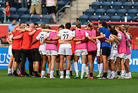 BRIDGEVIEW, IL - JULY 18: OL Reign huddle after a game between OL Reign and Chicago Red Stars at SeatGeek Stadium on July 18, 2021 in Bridgeview, Illinois.