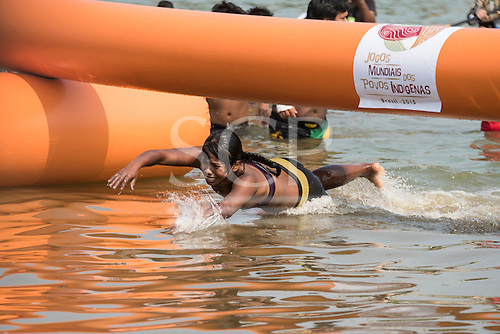 Amkrokwi Gaviåo, winner of the women's swimming heat, crosses the finishing line during the women's swimming event at the International Indigenous Games, in the city of Palmas, Tocantins State, Brazil. Photo © Sue Cunningham, pictures@scphotographic.com 30th October 2015