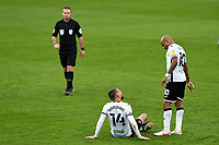 Conor Hourihane of Swansea City goes down injured during the Sky Bet Championship match between Swansea City and Cardiff City at the Liberty Stadium in Swansea, Wales, UK. Saturday 20 March 2021