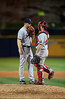Pawtucket Red Sox relief pitcher Blaine Boyer (61) talks with catcher Dan Butler (12) during a game against the Scranton/Wilkes-Barre RailRiders on May 15, 2017 at PNC Field in Moosic, Pennsylvania.  Scranton defeated Pawtucket 8-4.  (Mike Janes/Four Seam Images)