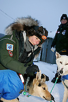 Thursday March 8, 2007   ----  Veterinarian Sarah Love tends to a Cindy Gallea dog at the Takotna checkpoint on Thursday morning.