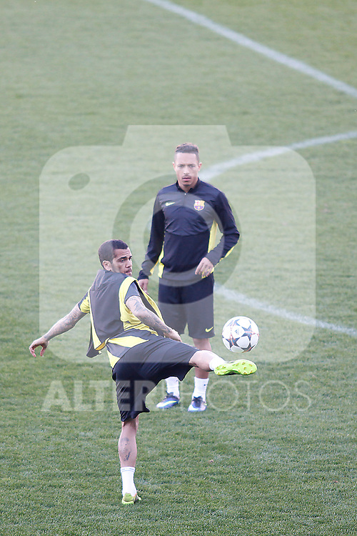 FC Barcelona´s Dani Alves and Adriano  during a training at the Vicente Calderon stadium in Madrid, Spain. Atletico de Madrid will face FC Barcelona in the second leg quarterfinal Champions League soccer match.  April 8, 2014. (ALTERPHOTOS/Victor Blanco)