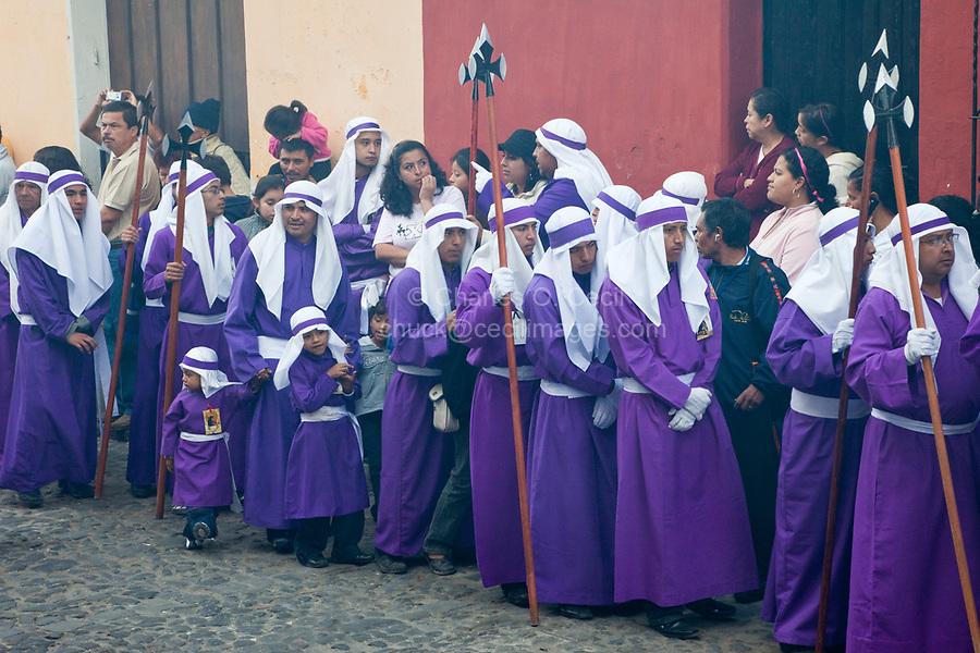 Antigua, Guatemala.  Cucuruchos Preceding a Float (Anda) in a Religious Procession during Holy Week, La Semana Santa.  Incense in the Air.