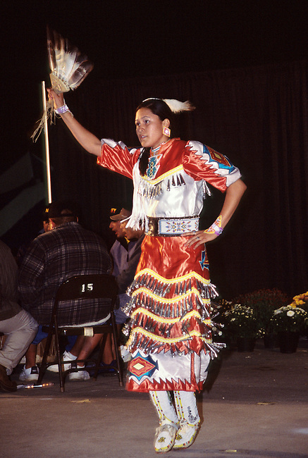 Teenage Cherokee girl dances a Jingle dance during a fall festival in Cherokee NC on the Qualla Indian Reservation