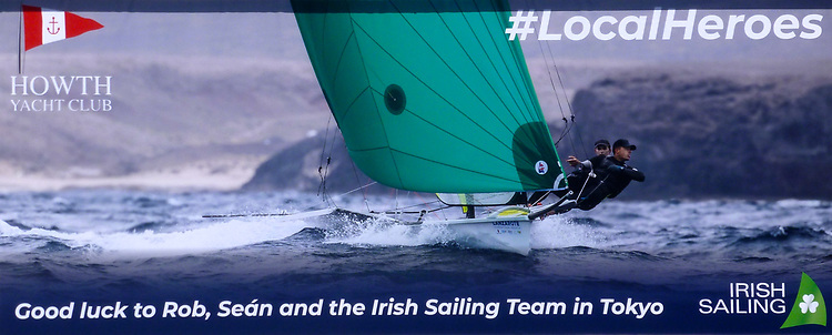 Serious picture. The new billboard posting on Howth YC's gable wall carries the hopes of a large community