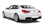 Rear three quarter view of a 2012 Bmw SERIES 6 Gran Coupe 640i 4 Door Sedan 2WD