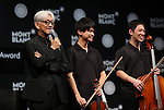"""December 21, 2016, Tokyo, Japan - Japanese composer Ryuichi Sakamoto (L), a member of the Yellow Magic Orchestra (YMO) smiles with young musicians after he received Montblanc de la Culture Arts Patronage Award in Tokyo on Wednesday, December 21, 2016. Sakamoto played his screen music """"Merry Christmas Mr. Lawrence"""" with young musicians.  (Photo by Yoshio Tsunoda/AFLO) LWX -ytd-"""