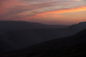 10/05/16 <br /> <br /> Smoke sits clings to the valley floor as the sun sets on a remote part of the Peak District between Sheffield and Manchester, where some 200 acres of precious heather moorland that was destroyed today after a BBQ started a fire in the valley below.<br /> <br /> Full story:   http://www.fstoppress.com/articles/peak-district-fire/<br /> <br /> .A small group of gamekeepers spent the night fighting a major blaze blaze covering two hundred acres of heather moorland close to the Derwent and Ladybower reservoirs in the Derbyshire Peak District.<br /> <br /> The fire, which broke out at around 1pm on Monday, is believed to have been started by a disposable barbecue, according to a spokesman for the reservoir, which quickly escalated into a major fire threatening the natural habitat of many wild animals and birds including red grouse, plovers, meadow pipits and hen harriers.<br /> <br /> Ten fire crews were called to tackle the flames, and remained on scene until dusk fell, leaving the job of managing the fire overnight to the gamekeepers on scene.<br /> <br /> Kieran Logan was one of the gamekeepers left battling the flames and he said moorland management policies implemented some 10 years ago by the landowners, The National Trust were also partly to blame.<br /> <br /> All Rights Reserved: F Stop Press Ltd. +44(0)1335 418365   +44 (0)7765 242650 www.fstoppress.com