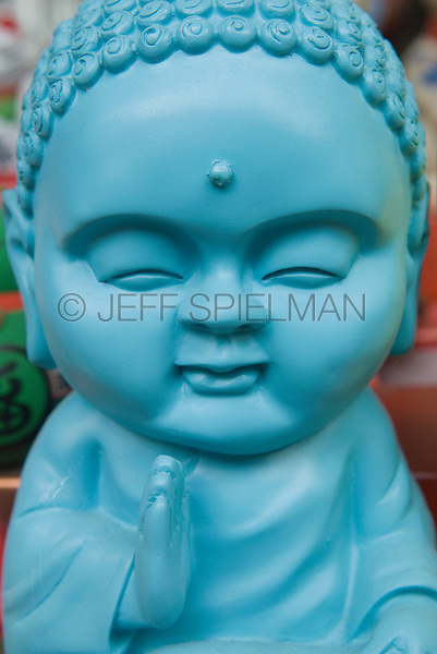 AVAILABLE FROM JEFF AS A FINE ART PRINT.<br /> <br /> AVAILABLE FROM JEFF FOR COMMERCIAL AND EDITORIAL LICENSING.<br /> <br /> Buddha Statues in a Store Window in Chinatown, New York City, New York State, USA