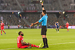 FIFA Referee Mohd Amirul Izwan of Malaysia (R) gets Saad Al Mukhaini of Oman (L) the yellow card during the AFC Asian Cup UAE 2019 Group F match between Oman (OMA) and Japan (JPN) at Zayed Sports City Stadium on 13 January 2019 in Abu Dhabi, United Arab Emirates. Photo by Marcio Rodrigo Machado / Power Sport Images