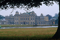 A view across the lake to the classical north facade of Badminton House which is thought to have been designed by John Webb