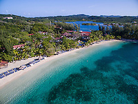 Honduras, Roatan Island, Fantasy Island Resort, Caribbean. Overview of 22 acre Fantasy Island from and Inspire drone.