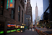 April 12, 2020<br /> New York, New York<br /> <br /> The Empire State Building looms over an empty 34th Street at dusk during the height of the coronavirus pandemic. More than 10,000 deaths reported throughout the state.