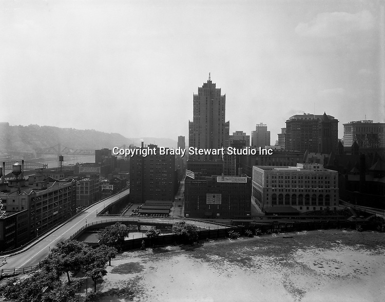 Pittsburgh PA:  View of Pittsburgh and the Monongahela River from the bluff at Duquesne University.<br /> The Grant Building (tallest), Frick Building (next to Grant Bldg), Oliver Building (far right), and Arrott Building (between Grant and Frick buildings) are in the shot