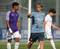 Julien Duranville (8) of Anderlecht and physical coach Hubert Lemaire of Anderlecht entering the pitch before the warm up before a friendly soccer game between K Londerzeel SK and RSC Anderlecht Reserves during the preparations for the 2021-2022 season , on Wednesday 21st of July 2021 in Londerzeel , Belgium . PHOTO SEVIL OKTEM | SPORTPIX