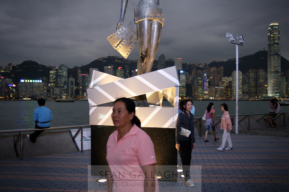 CHINA. Hong Kong. Tourists in Kowloon. Officially the Hong Kong Special Administrative Region, it is a territory located on China's south coast on the Pearl River Delta. It has a population of 6.9 million people, and is one of the most densely populated areas in the world. 2008