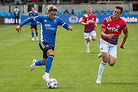 SAN JOSE, CA - APRIL 24: Cade Cowell #44 of the San Jose Earthquakes dribbles past Jose Martinez #3 of FC Dallas during a game between FC Dallas and San Jose Earthquakes at PayPal Park on April 24, 2021 in San Jose, California.