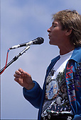 Singer John Denver performs at an Earth Day rally at the United States Capitol in Washington, DC on April 22, 1990.  The event celebrated the 20th anniversary of Earth Day.<br /> Credit: Howard L. Sachs / CNP