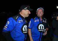 Nov. 11, 2012; Pomona, CA, USA: NHRA pro stock driver Allen Johnson (right) celebrates with crew member Jim Yates after winning the Auto Club Finals at at Auto Club Raceway at Pomona. Mandatory Credit: Mark J. Rebilas-