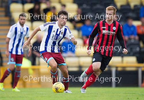 St Johnstone v Real Sociadad...12.07.15  Bayview, Methil (Home of East Fife FC)<br /> Ruben Pardo is closed down by Liam Caddis<br /> Picture by Graeme Hart.<br /> Copyright Perthshire Picture Agency<br /> Tel: 01738 623350  Mobile: 07990 594431