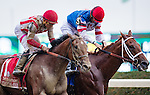 ELMONT, NY - OCTOBER 08: Practical Joke #1 (left), ridden by Joel Rosario, catches Syndergaard #3, ridden by John Velazquez at the wire to win by a nose in the Champagne Stakes on Jockey Club Gold Cup Day at Belmont Park on October 8, 2016 in Elmont, New York. (Photo by Doug DeFelice/Eclipse Sportswire/Getty Images)