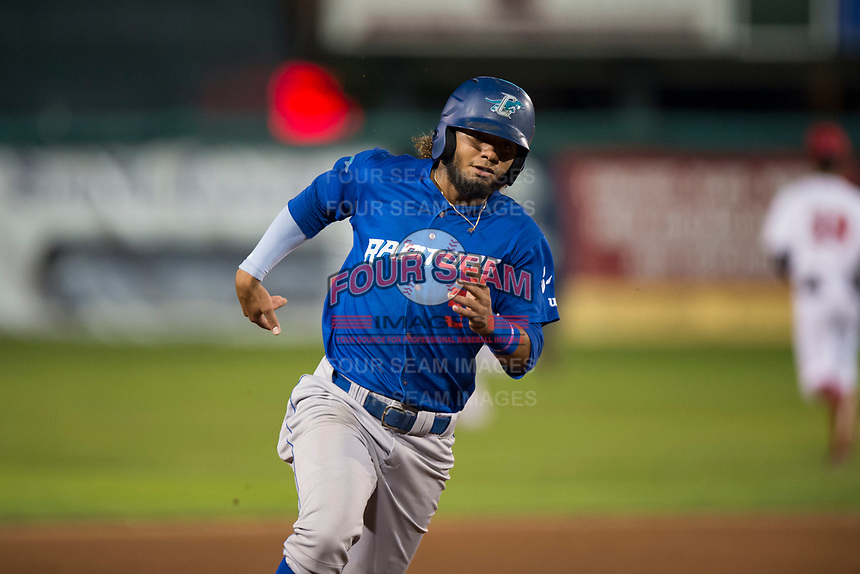 Ogden Raptors shortstop Ronny Brito (5) rounds third base during a Pioneer League game against the Orem Owlz at Home of the OWLZ on August 24, 2018 in Orem, Utah. The Ogden Raptors defeated the Orem Owlz by a score of 13-5. (Zachary Lucy/Four Seam Images)
