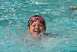 SOUTHBURY, CT--- -070515JS04-- Zara Kosovac, 5, of Southbury, practices her swimming Sunday at the Southbury town swimming pool at Ballatine Park in Southbury. Zara was at the pool with her father. <br /> Jim Shannon Republican-American