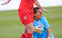 CARSON, CA - FEBRUARY 07: María Noelia Bermudez #1 GK of Costa Rica takes a Canadian knee to the head during a game between Canada and Costa Rica at Dignity Health Sports Park on February 07, 2020 in Carson, California.