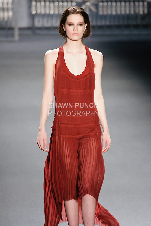 Caroline Brasch Nielsen walks runway in a cardamon chiffon multi-pleated racer-back gown with high-low hem and pleated strap detail, from the Vera Wang Fall 2011 collection, during Mercedes-Benz Fashion Week Fall 2011.