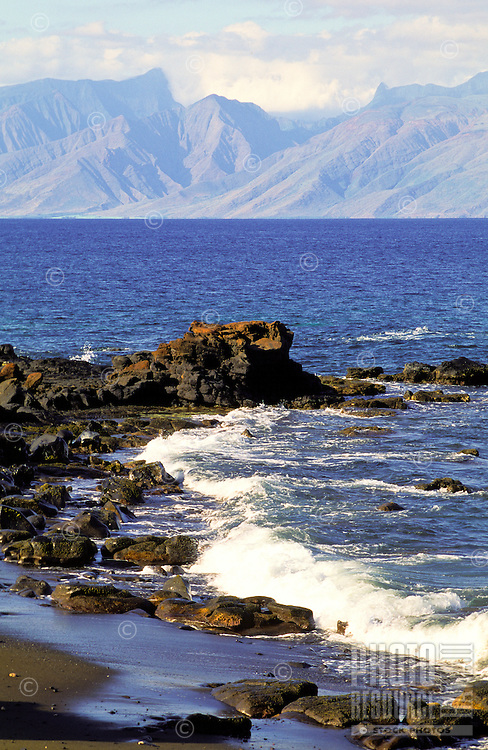 The West Maui mountains as seen from the rocky shoreline on Kahoolawe.