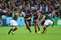 07 October 2015: Andrew Suniula of USA is about to be tackled by Rudy Paige and Morne Steyn of South Africa as Folau Niua of USA supports during Match 31 of the Rugby World Cup 2015 between South Africa and USA - Queen Elizabeth Olympic Park, London, England (Photo by Rob Munro/CSM)