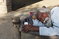 """""""There's no money, no medicine. I'm waiting for death"""", says Harneg Singh, 65, as he lies on a bed outside his home in the Punjab region of northwest India. He is one of many villagers suffering from Hepatitis C. It is believed decades of excessive pesticide use in the region has contributed to weakening people's immune systems, making them more susceptible to diseases. Many villagers cannot afford the expensive treatments and medicines that would either save them of prolong their lives."""