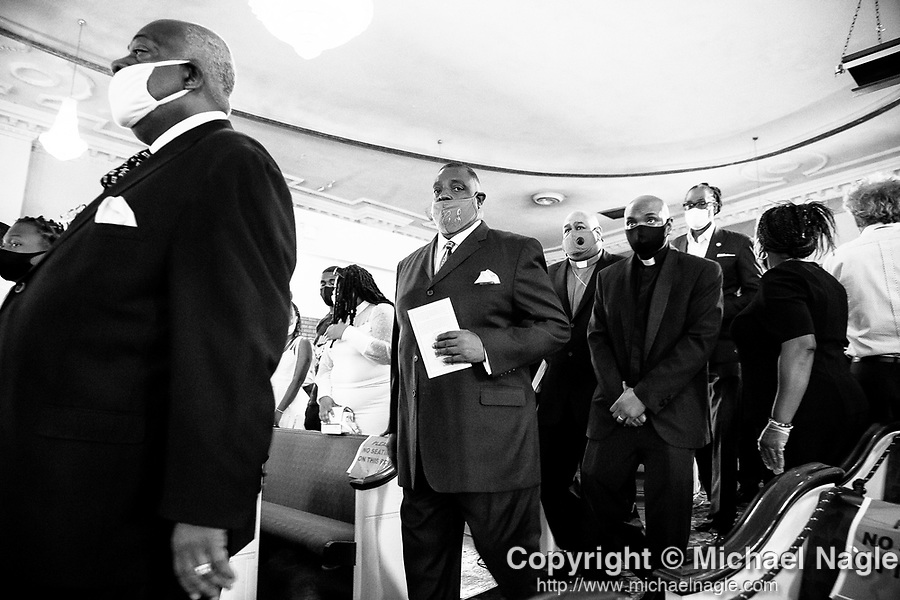 Religious leaders attend the funeral for one year-old Davell Gardner Jr. at Pleasant Grove Tabernacle on July 27, 2020 in the Brooklyn borough of New York City.  Gardner was shot and killed earlier this month during a cookout in front of his home along with three others.  Photograph by Michael Nagle