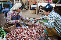 Myanmar, Burma.  Customer Selecting Onions.  Bagan Market.