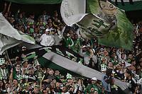 BOGOTÁ -COLOMBIA-01-11-2014. Hinchas de Nacional alientan a su equipo durante el partido entre Fortaleza FC y Atlético Nacional por la fecha 17 de la Liga Postobón II 2014 jugado en el estadio Nemesio Camacho El Campín en Bogotá./  Follower of Nacional encourege their team match between Fortaleza FC and Atletico Nacional for the 17th date of Postobon League II 2014 played at Nemesio Camacho El Campin stadium in Bogota. Photo: VizzorImage / Gabriel Aponte / Staff