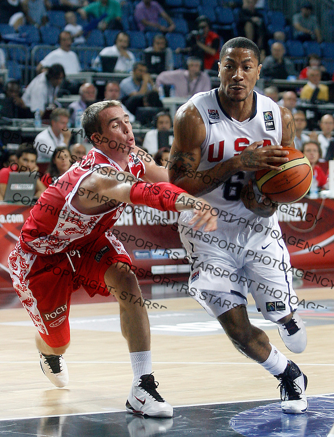 Derrick ROSE (USA)  passes Sergei BYKOV (Russia)  during the quarter-final World championship basketball match against Russia in Istanbul, USA-Russia, Turkey on Thursday, Sep. 09, 2010..