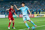 Shanghai FC Forward Oscar Emboaba Junior (L) and Jiangsu FC Defender Li Ang (R) gestures during the AFC Champions League 2017 Round of 16 match between Jiangsu FC (CHN) vs Shanghai SIPG FC (CHN) at the Nanjing Olympic Stadium on 31 May 2017 in Nanjing, China. Photo by Marcio Rodrigo Machado / Power Sport Images