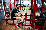 bodybuilder Palestinian, Nidal al-Daour 30, who lost his hand, trains during an exercise session, at his gym, in Beit Lahia, in the northern Gaza Strip, on April 12, 2021. Al-daour lost his hand during the 2008 war during his career as a medic. He workes a trainer in bodybuilding, and opened a gym, where he made a special device to be able to lift weights. Photo by Mohammed Salem