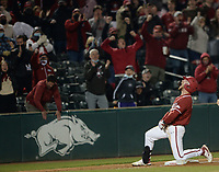 Arkansas pinch hitter Zack Gregory reacts Friday, April 2, 2021, after hitting an RBI triple during the seventh inning of play against Auburn at Baum-Walker Stadium in Fayetteville. Visit nwaonline.com/210403Daily/ for today's photo gallery. <br /> (NWA Democrat-Gazette/Andy Shupe)
