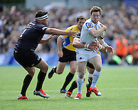 Will Chudley of Exeter Chiefs is tackled by Kelly Brown of Saracens as Jamie George of Saracens supports