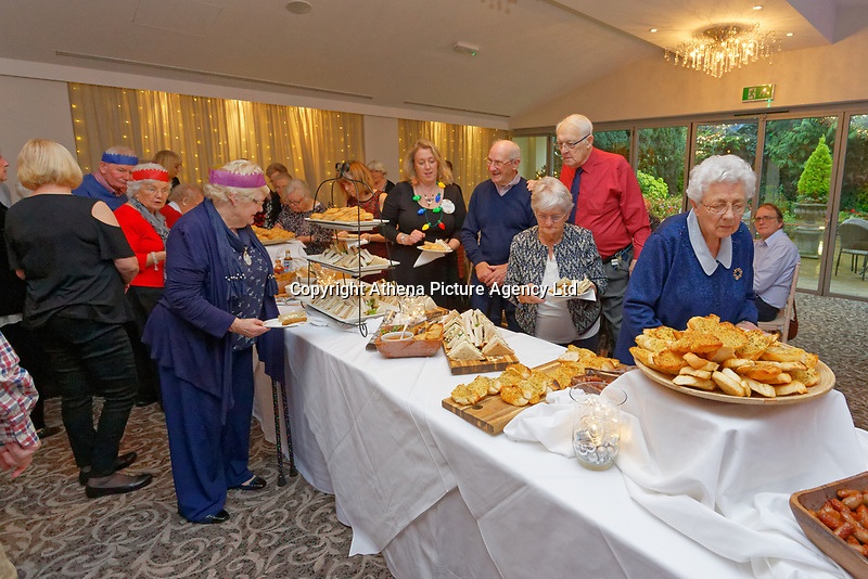 Pictured: Guests at the buffet. Wednesday 28 November 2018<br /> Re: National Lottery millionaires from south Wales and the south west of England have hosted a glitzy Rat Pack-inspired Christmas party for an older people's music group at The Bear Hotel in Cowbridge, Wales, UK.