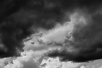 Cumulus with vertical growth, warning of afternoon showers